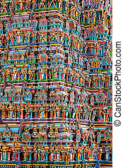 Hindu temple gopura tower with statues - Hindu temple gopura...