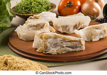 Raw pig tails on wooden background