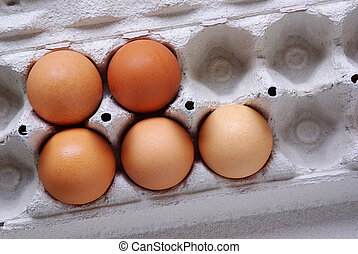 Five Eggs - Close-up of five fresh eggs in a box made of...