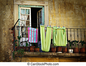 Hanged Clothes - Old house and balcony with hanged clothes