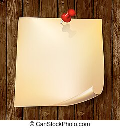 Note paper with red pin on wood background.