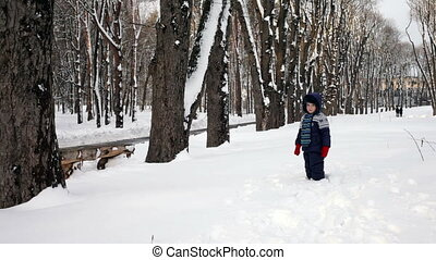 Cheerful child playing in the snow