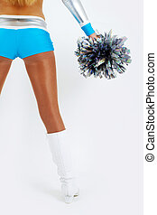 A cheerleader with a pom-pom seen from the back - Picture of...