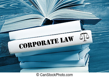 Book with Corporate Law word on table in a courtroom or...