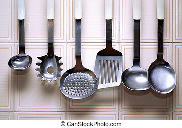 Kitchen Utensils - A collection of kitchen utensils hanged...