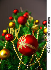 Red ball - Detail of a Christmas tree with focus in a red...