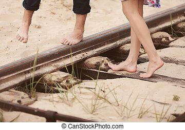 a pair of lovers, women while embracing her man at railway...