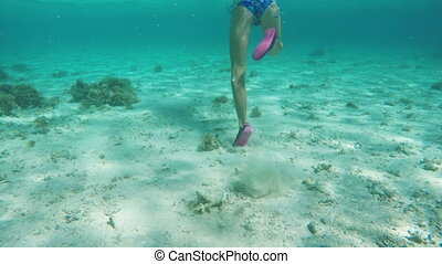Young girl scuba diver - Childrens legs running on the...