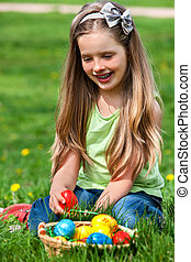 Child find easter egg outdoor - Happy child sitting and find...