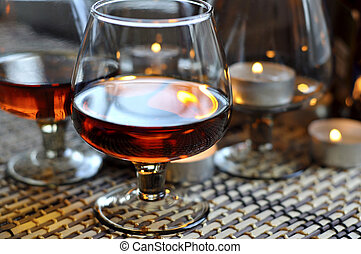 Brandy in a glass - a glass of brandy and a candle