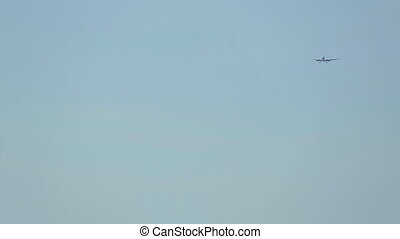 Airplane approaching - Boeing 767 approaching over ocean at...