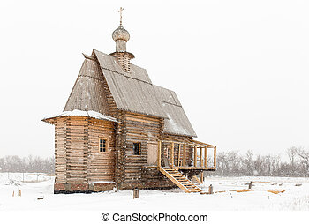 Wooden church in winter - Wooden old church in Russia at...