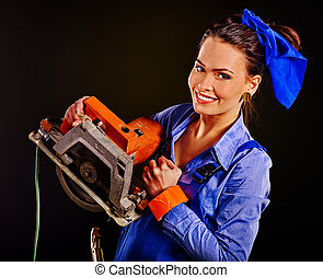 Woman in builder clothers holding circular saw - Happy woman...