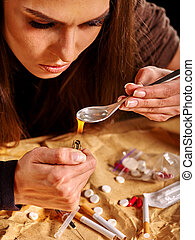 Girl addict with heroin spoon and lighter. Sossial issues on...
