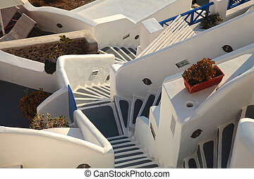 White and grey steps in Oia, Santorini, Greece selective...