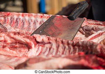 Cleaver - Still life with a cleaver surrounded by pork rib...