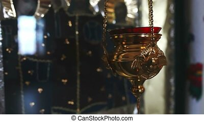 Lamp with a candle is lit in the church religion - Lamp with...