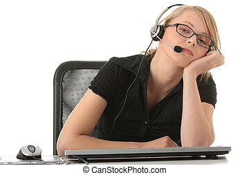 Young beautiful girl in headset,sitting at the desk bored,...