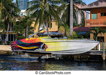 Speedboat in front of the luxury villa in the Sunny Isles...
