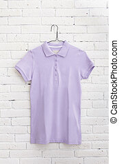 purple shirt hanging on the wall
