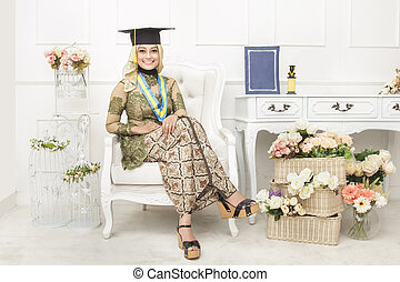 female graduated student wearing indonesian traditional clothes