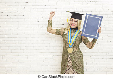 success of graduated indonesian female student wearing traditional clothes