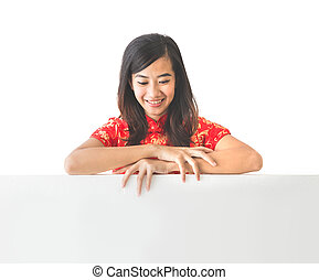 asian woman wearing traditional chinese dress holding blank white board