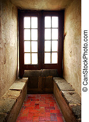 Medieval Window - Sof light entering from a old window of a...
