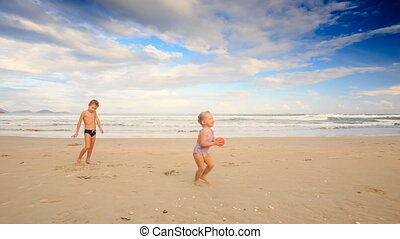 Kids Girl with Pigtail Boy Throw Catch Ball on Sand Beach -...