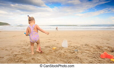 Kids Small Girl Boy Run Play Red Ball on Wet Sand Beach -...