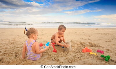 Kids Small Girl Boy Play Try to Make Sand Cake on Beach -...