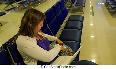 Blond Girl Puts Iphone Laptop into Bag Goes at Airport...