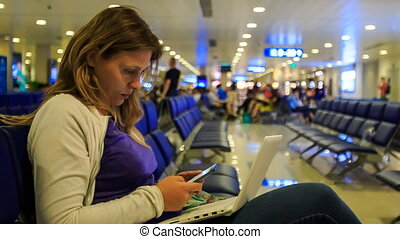 Closeup Blond Girl Works on Laptop Answers sms in Terminal -...