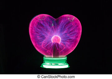 Plasma ball heart glowing in the dark isolated on black
