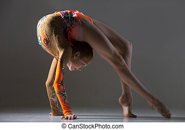 Dancer girl doing bridge exercise - Beautiful gymnast...