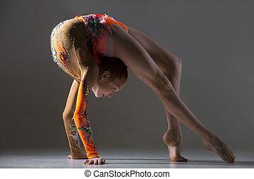 Dancer girl doing bridge exercise - Beautiful gymnast...