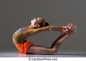 Dancer girl doing backbend athletic exercise - Beautiful...