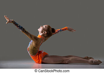 Dancer girl doing backbend gymnastics exercise - Beautiful...