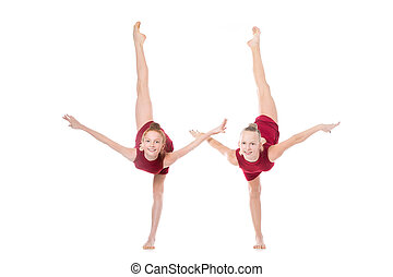 Two dancer girls doing standing backbend - Group of two...