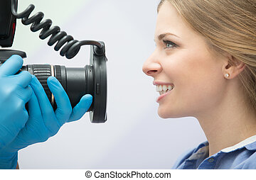 Dentist with camera and patient - Dentist with camera making...