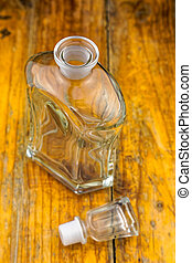 Glass Decanter on Wooden Table - An elegant glass decanter...