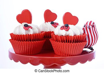 Red and white Valentine cupcakes with hearts and love bug...