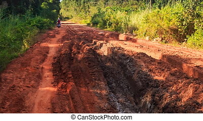 Closeup Rural Road with Deep Dirty Track after Rain