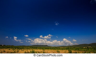 White Cumulus Clouds Motion in Blue Sky over Rural Landscape...