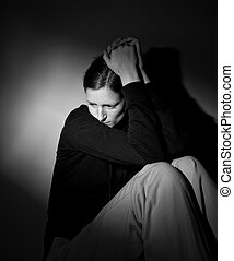 Young woman suffering from a severe depressionanxiety -...