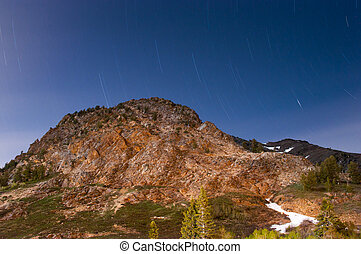 Skys are Spinning - Star trails above a mountain near the...