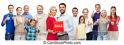 happy people with red sale sign showing thumbs up - gesture,...