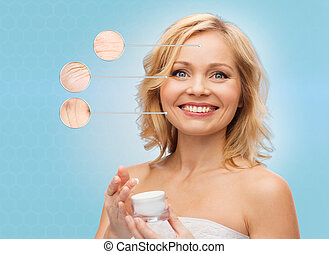 happy woman with anti-aging cream jar - beauty, people,...