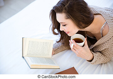 Lovely woman reading book and drinking coffee - Cute lovely...