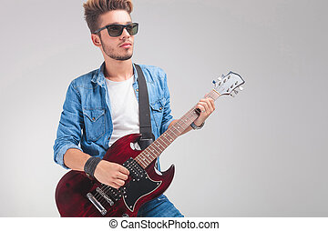 guy wearing sunglasses while playing the guitar - cool guy...